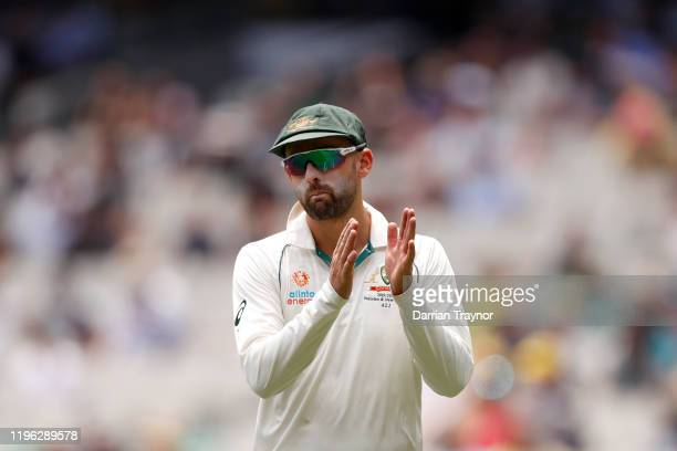 Nathan Lyon of Australia acknowledges the crowd during day three of the Second Test match in the series between Australia and New Zealand at...