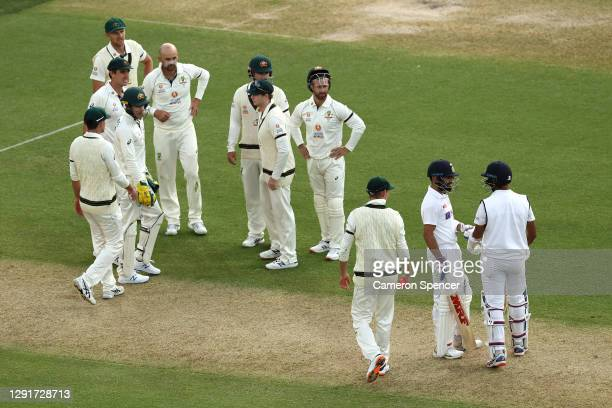 Nathan Lyon of Australia and team mates wait for a DRS decision after appealing for the wicket of Cheteshwar Pujara of India during day one of the...