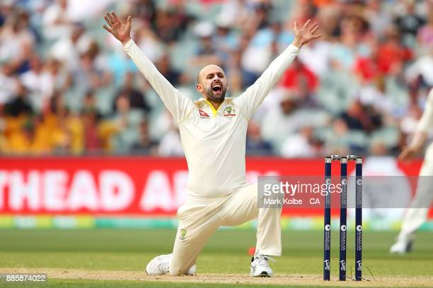 Nathan Lyon of Australia appeals for the wicket of Alastair Cook of England which was given not out only to be overruled by the DRS during day four...