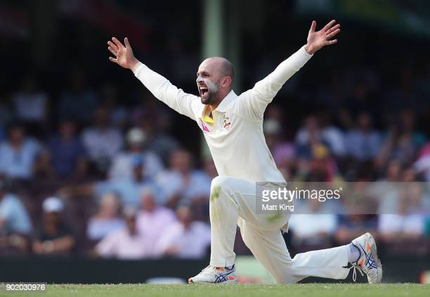 Nathan Lyon of Australia appeals successfully for the wicket of Dawid Malan of England during day four of the Fifth Test match in the 2017/18 Ashes...