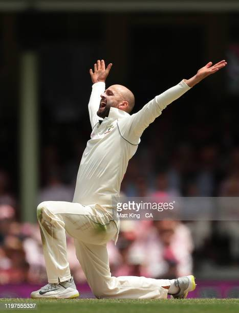 Nathan Lyon of Australia appeals successfully for the wicket of Jeet Raval of New Zealand during day three of the Third Test match in the series...