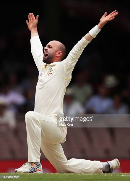 Nathan Lyon of Australia appeals successfully for the wicket of Moeen Ali of England during day five of the Fifth Test match in the 2017/18 Ashes...
