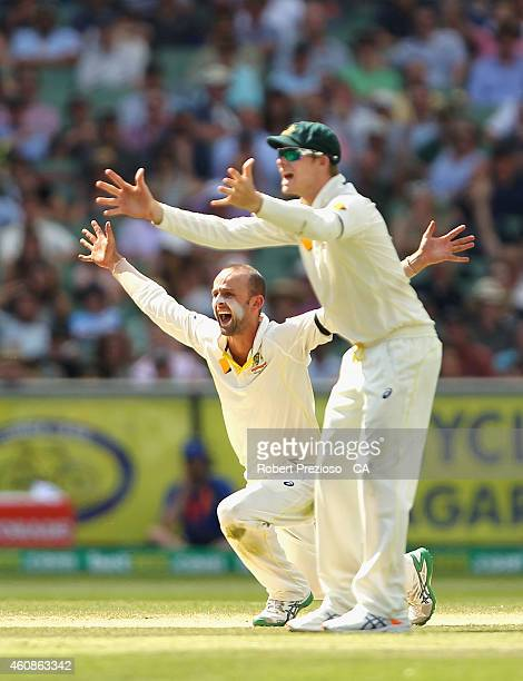 Nathan Lyon of Australia appeals successfully for the wicket of Ajinkya Rahane of India during day three of the Third Test match between Australia...
