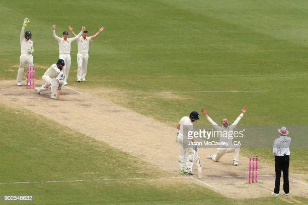 Nathan Lyon of Australia appeals the wicket of Moeen Ali of England during day five of the Fifth Test match in the 2017/18 Ashes Series between...