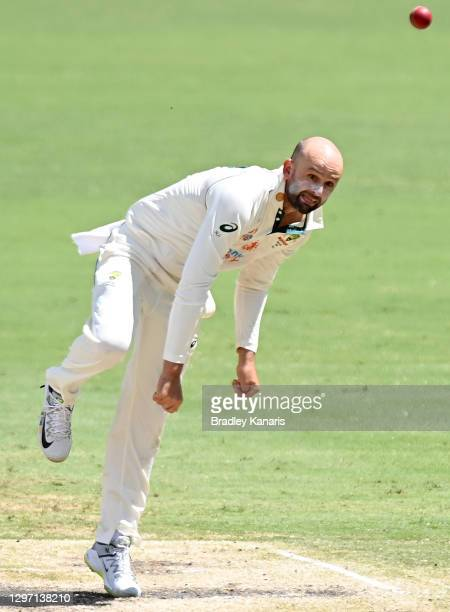 Nathan Lyon of Australia bowls during day five of the 4th Test Match in the series between Australia and India at The Gabba on January 19, 2021 in...