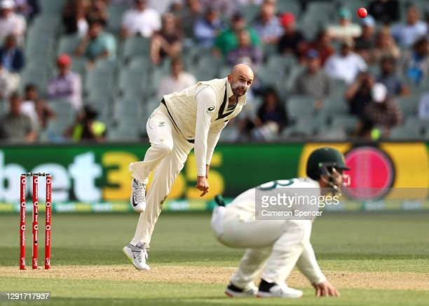 Nathan Lyon of Australia bowls during day one of the First Test match between Australia and India at Adelaide Oval on December 17, 2020 in Adelaide,...