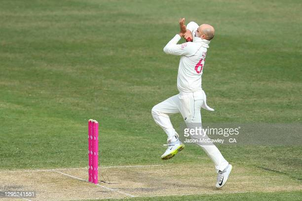 Nathan Lyon of Australia bowls during day two of the 3rd Test match in the series between Australia and India at Sydney Cricket Ground on January 08,...