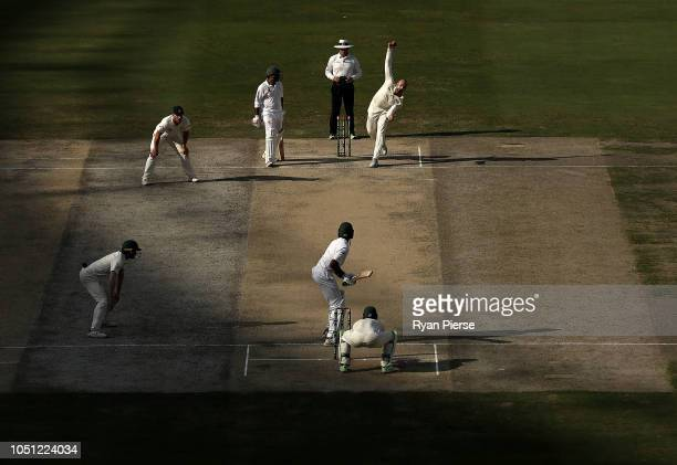 Nathan Lyon of Australia bowls during day two of the First Test match in the series between Australia and Pakistan at Dubai International Stadium on...