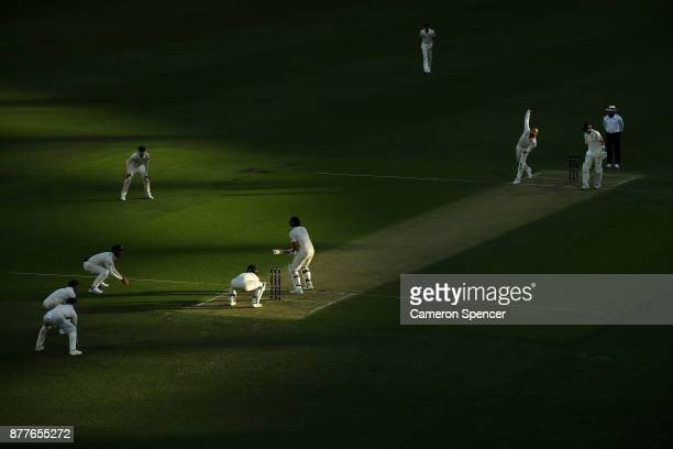 Nathan Lyon of Australia bowls to Dawid Malan of England during day one of the First Test Match of the 2017/18 Ashes Series between Australia and...