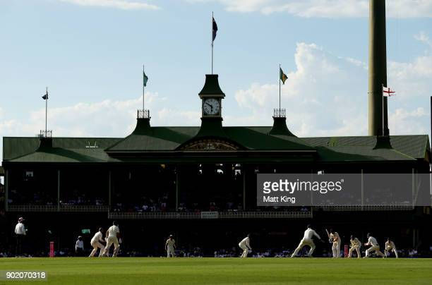 Nathan Lyon of Australia bowls to Joe Root of England during day four of the Fifth Test match in the 2017/18 Ashes Series between Australia and...