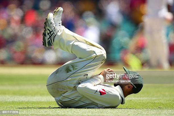 Nathan Lyon of Australia catches MisbahulHaq of Pakistan off a delivery by team mate Steve O'Keefe during day five of the Third Test match between...