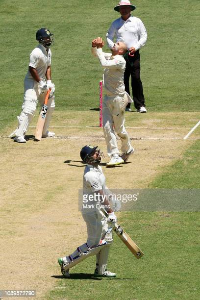 Nathan Lyon of Australia catches out Cheteshwar Pujara of India during day two of the Fourth Test match in the series between Australia and India at...