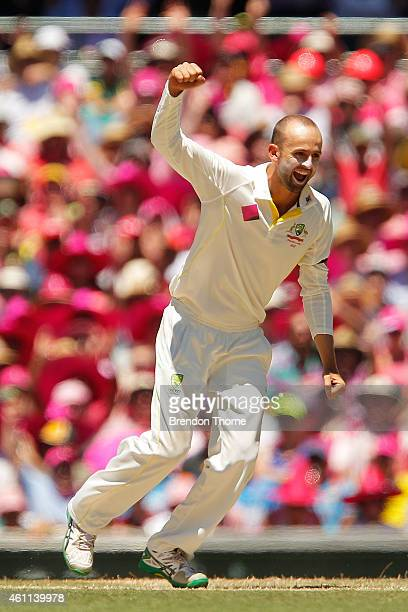 Nathan Lyon of Australia celebrates after claiming the wicket of Rohit Sharma of India during day three of the Fourth Test match between Australia...