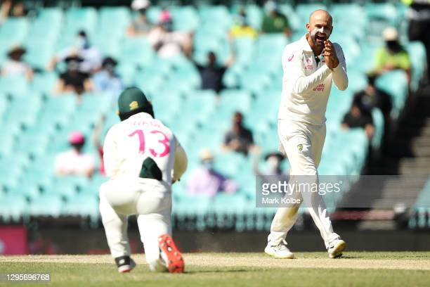 Nathan Lyon of Australia celebrates after Matthew Wade of Australia took the catch to dismiss Ajinkya Rahane of India during day five of the Third...