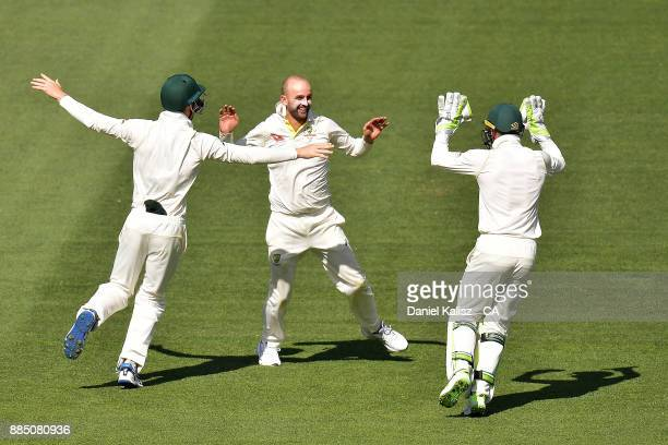 Nathan Lyon of Australia celebrates after taking a catch to dismiss Moeen Ali of England during day three of the Second Test match during the 2017/18...