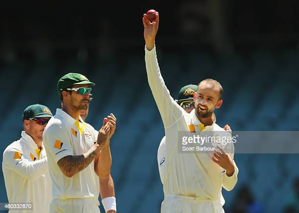 Nathan Lyon of Australia celebrates after taking his fifth wicket the wicket of Ishant Sharma of India during day four of the First Test match...