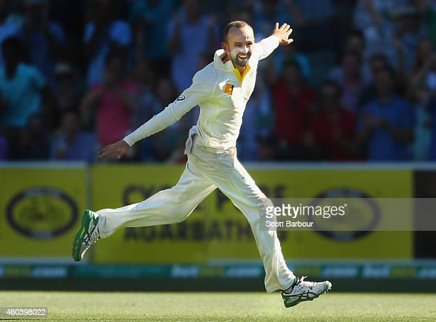 Nathan Lyon of Australia celebrates after taking the last wicket to win the match day five of the First Test match between Australia and India at the...