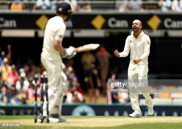 Nathan Lyon of Australia celebrates after taking the wicket of Chris Woakes of England during day two of the First Test Match of the 2017/18 Ashes...