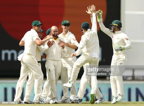 Nathan Lyon of Australia celebrates after taking the wicket of Joe Root of England during day four of the Third Test match during the 2017/18 Ashes...