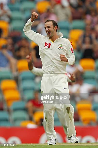 Nathan Lyon of Australia celebrates after taking the wicket of Kane Williamson of New Zealand during day one of the First Test match between...