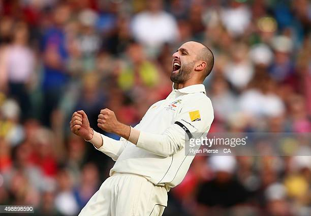 Nathan Lyon of Australia celebrates after taking the wicket of Mark Craig of New Zealand during day one of the Third Test match between Australia and...