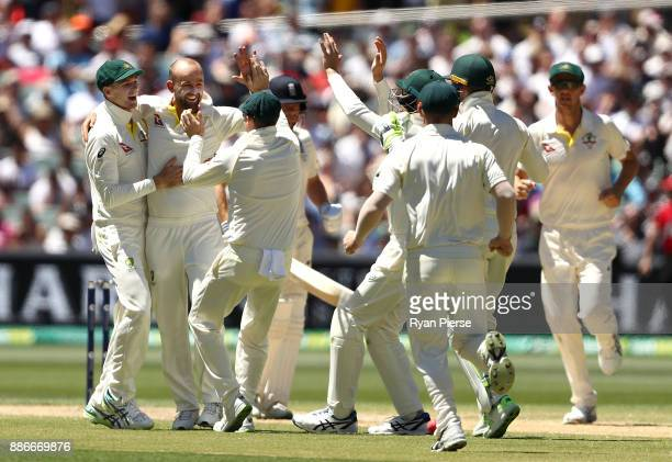 Nathan Lyon of Australia celebrates after taking the wicket of Moeen Ali of England during day five of the Second Test match during the 2017/18 Ashes...