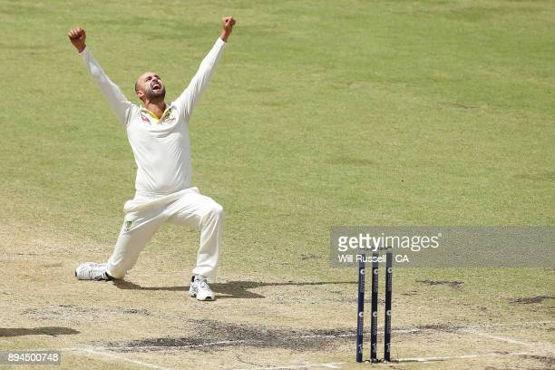 Nathan Lyon of Australia celebrates after taking the wicket of Moeen Ali of England during day five of the Third Test match during the 2017/18 Ashes...