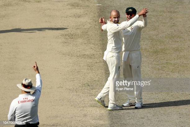 Nathan Lyon of Australia celebrates after taking the wicket of ImamUlHaq of Pakistan off the bowling of Nathan Lyon of Australia during day one of...