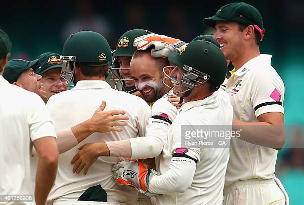 Nathan Lyon of Australia celebrates after taking the wicket of Wriddhiman Saha of India during day five of the Fourth Test match between Australia...