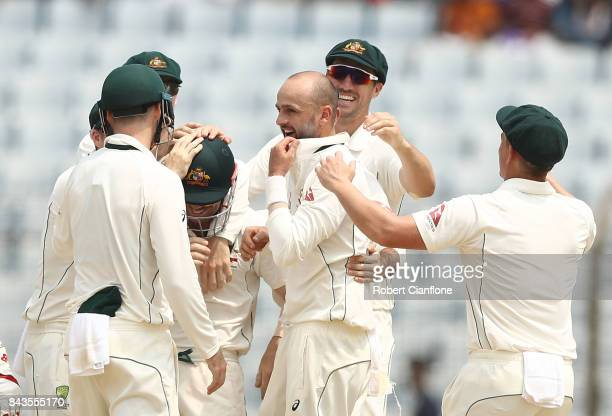 Nathan Lyon of Australia celebrates after taking the wicket of Shakib Al Hasan of Bangladesh during day four of the Second Test match between...