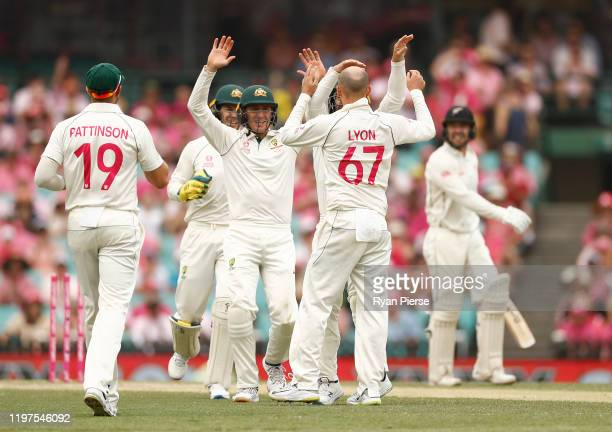 Nathan Lyon of Australia celebrates after taking the wicket of Tom Blundell of New Zealand during day three of the Third Test match in the series...