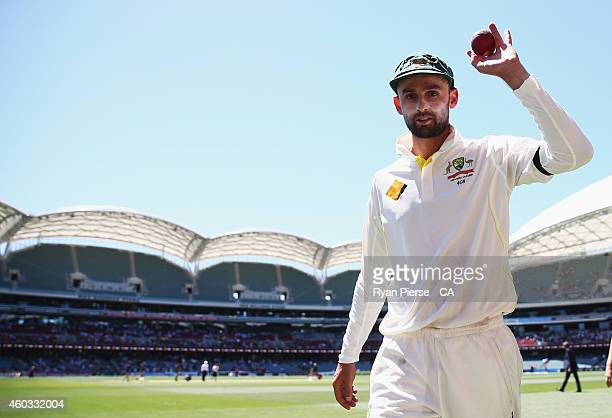 Nathan Lyon of Australia celebrates as he leaves the ground after taking five wickets during day four of the First Test match between Australia and...