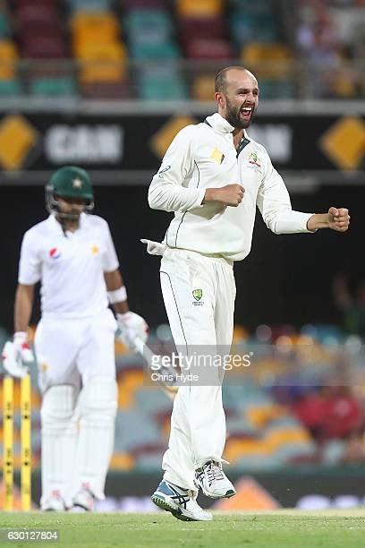 Nathan Lyon of Australia celebrates dismissing Babar Azam of Pakistan during day three of the First Test match between Australia and Pakistan at The...