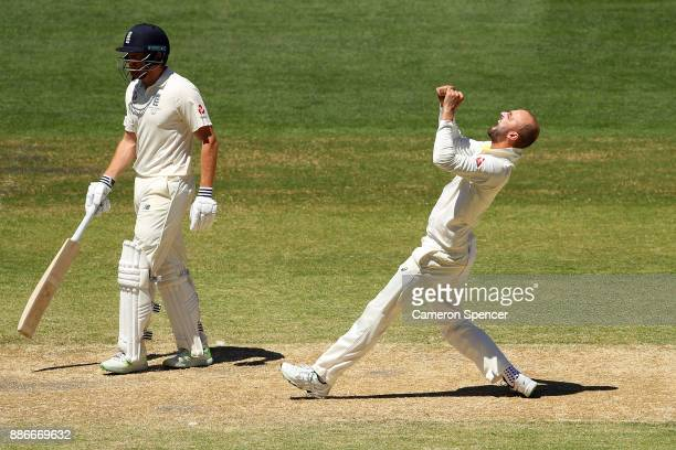 Nathan Lyon of Australia celebrates dismissing Moeen Ali of England during day five of the Second Test match during the 2017/18 Ashes Series between...