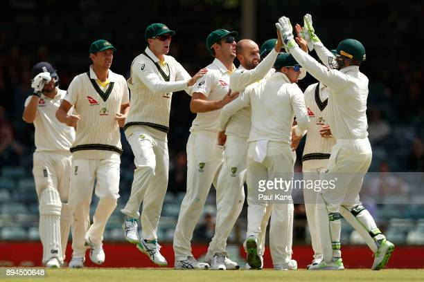Nathan Lyon of Australia celebrates dismissing Moeen Ali of England during day five of the Third Test match during the 2017/18 Ashes Series between...