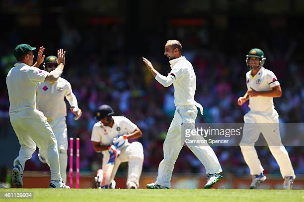 Nathan Lyon of Australia celebrates dismissing Rohit Sharma of India during day three of the Fourth Test match between Australia and India at Sydney...