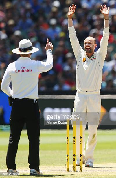 Nathan Lyon of Australia celebrates his dismissal Jerome Taylor of the West Indies during day three of the Second Test match between Australia and...
