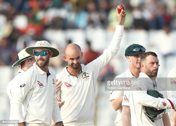 Nathan Lyon of Australia celebrates his five wickets for the innings after taking the wicket of Shabbir Rahman Roman of Bangladesh during day one of...