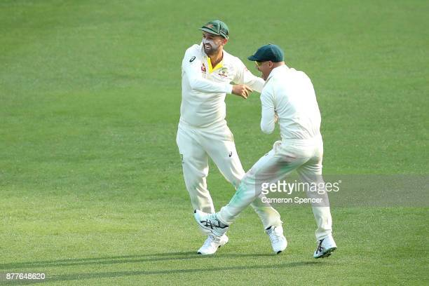 Nathan Lyon of Australia celebrates running out James Vince of England during day one of the First Test Match of the 2017/18 Ashes Series between...