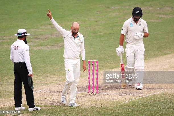 Nathan Lyon of Australia celebrates taking the wicket of Colin de Grandhomme of New Zealand during day four of the Third Test Match in the series...