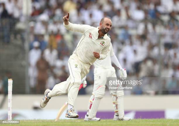 Nathan Lyon of Australia celebrates taking the wicket of Mushfiqur Rahim of Bangladesh during day three of the First Test match between Bangladesh...