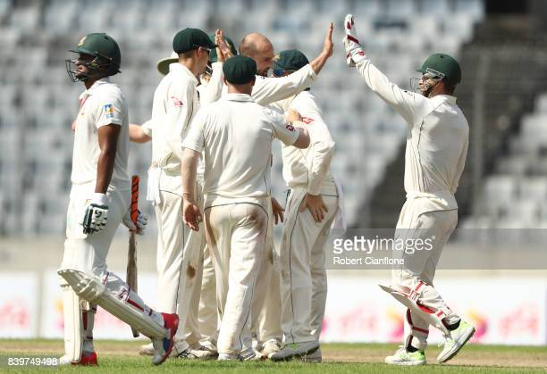 Nathan Lyon of Australia celebrates taking the wicket of Shakib Al Hasan of Bangladesh during day one of the First Test match between Bangladesh and...