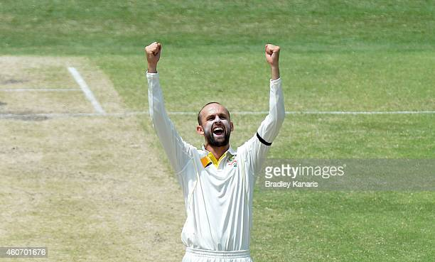 Nathan Lyon of Australia celebrates taking the wicket of Shikhar Dhawan of India during day four of the 2nd Test match between Australia and India at...