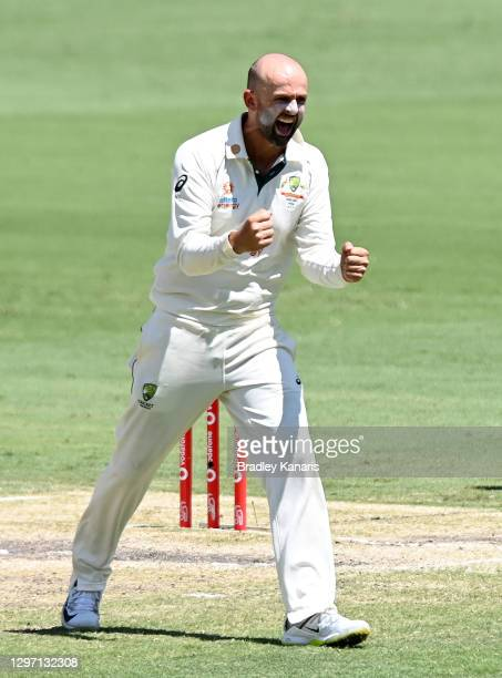 Nathan Lyon of Australia celebrates taking the wicket of Shubman Gill of India during day five of the 4th Test Match in the series between Australia...