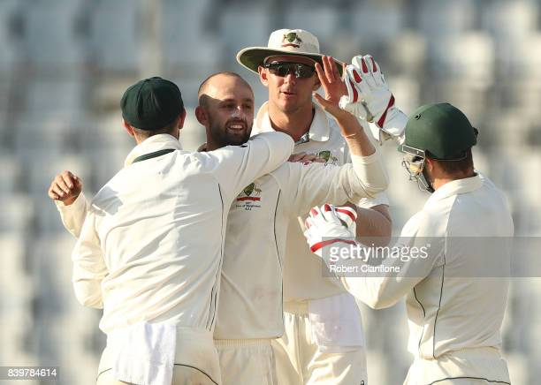 Nathan Lyon of Australia celebrates taking the wicket of Taijul Islam of Bangladesh during day one of the First Test match between Bangladesh and...