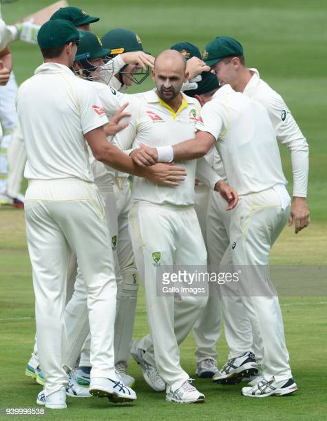 Nathan Lyon of Australia celebrates the wicket of Dean Elgar of the Proteas with his team mates during day 1 of the 4th Sunfoil Test match between...