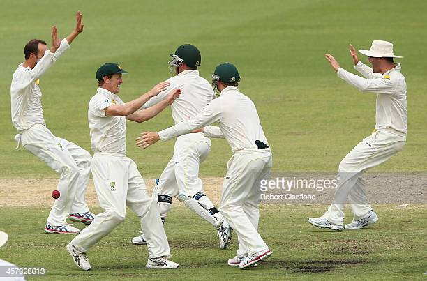Nathan Lyon of Australia celebrates the wicket of Graeme Swann of England during day five of the Third Ashes Test Match between Australia and England...