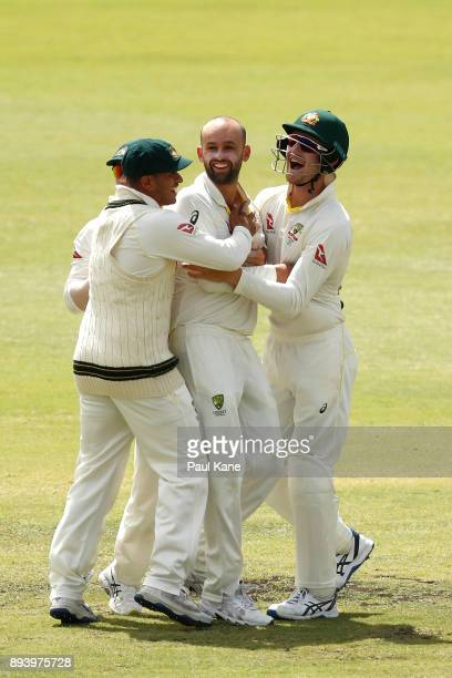 Nathan Lyon of Australia celebrates the wicket of Joe Root of England with Usman Khawaja and Cameron Bancroft during day four of the Third Test match...