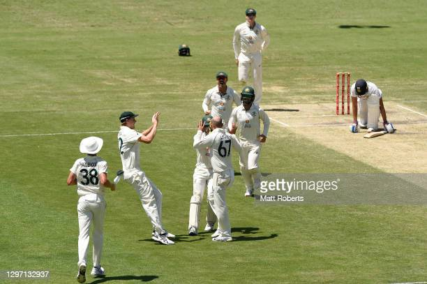 Nathan Lyon of Australia celebrates the wicket of Shubman Gill of India during day five of the 4th Test Match in the series between Australia and...