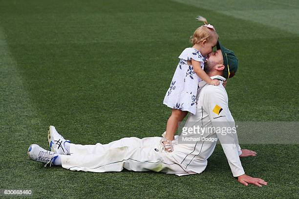 Nathan Lyon of Australia celebrates the win with his daughter during day five of the Second Test match between Australia and Pakistan at Melbourne...